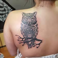 the best shoulder tattoos designs black ink tribal owl on branch tattoo on left back shoulder