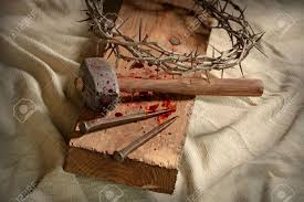 crown of thorns nails and hammer on wooden cross stock photo