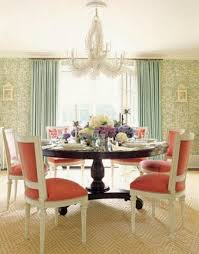 elegance dining room with wooden round table pink chairs green