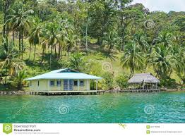 house and hut over water caribbean coast of panama stock photo
