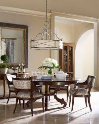 dining room dark expandable round dining table with upholstered