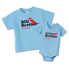 matching big shirts dinosaur sibling