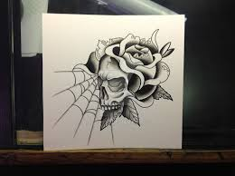 rose and skull tattoo design