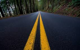 why do some roads have white markings while others have yellow