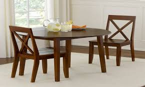 big round narrow dining table 2 dining chairs have some glasses