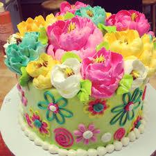 adorable flower themed buttercream birthday cake from the white