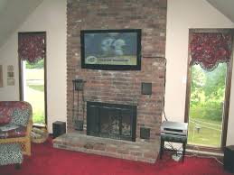 tv on top of fireplace on top of fireplace large size of top hang above brick tv on top of fireplace