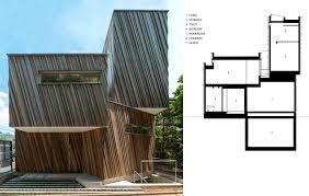 japanese studio sandwich wraps a passive solar home in diagonal