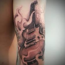 Guitar Tattoo Designs Ideas Skin Burning Tattoos Ripped Skin Flame Guitar Tattoo On Arm