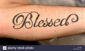 tattoo text arm a blessed tattoo on a mans arm stock photo royalty free image