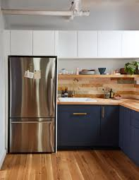 ikea navy blue kitchen cabinets you ll the mix of high and low in this small kitchen