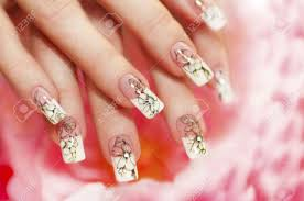 floral french manicure on the pink white background stock photo