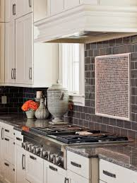 Stainless Steel Canisters Kitchen Backsplashes White Kitchen Cabinets Dark Gray Subway Tile
