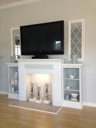 Faux Fireplace Tv Stand - love this faux mantle with candles and side shelves for a