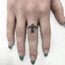 eagle tattoo on finger owl tree finger tattoos tattoos pinterest tattoo piercing
