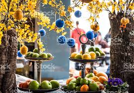 Easter Egg Decorating London easter decoration display and citrus fruit in london cafe stock