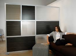 white and black room divider with white alumunium frames on the