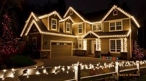 c9 lights decorate the house while the fence is wrapped with mini