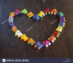heart shaped items toys cars brightly lined up heart form toys cars plastic
