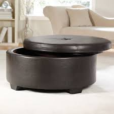 custom round brown leather ottoman on light brown ceramic tiled