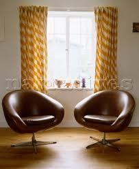 Retro Swivel Armchair Ac039 03 Pair Of Brown Leather Retro Style Swivel Cha