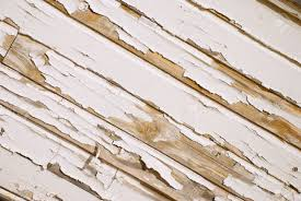 a very old wooden slat wall with serverly distressed and cracked