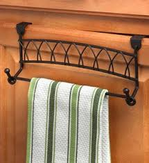 over cabinet door towel bar use this twist over cabinet towel bar to increase storage in small