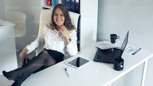 successful business woman at the office with her feet on the desk