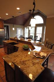 Unfinished Kitchen Island With Seating by Great Two Hanging Kitchen Lamps Over White Marble Top Kitchen