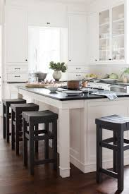 small black wooden kitchen island with seating neat porcelain