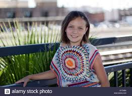a young pre teen caucasian modeling 1960s style tie dyed