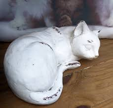 free photo sleeping cat outdoors garden ornament painted clay