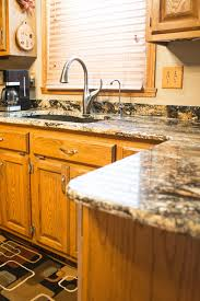 what color granite goes with golden oak cabinets gold color granite countertops kitchen ideas gold trend