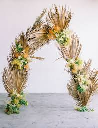 wedding arch leaves dried palm leaves are the wedding decor trend brides