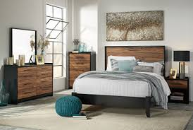 Black Panel Bed Stavani Black And Brown Panel Bedroom Set From Ashley Coleman