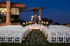 white aisle markers altar arch arrangements fall outdoor ceremony