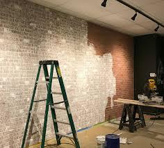 faux brick wall created from brick paneling jennifer decorates
