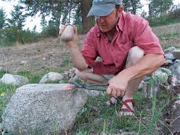 a cutting edge creating a steel blade in a primitive setting