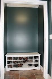 walk in closet ideas with small black coat white shoe and storage