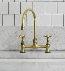 kingston brass kitchen faucets unlacquered brass bridge faucet also green tips kingston brass