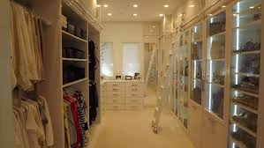 interior spacious walk in dressing room design with white glass