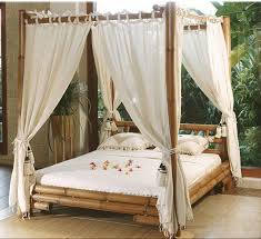 bamboo canopy bed frame using white curtain placed in comfortable
