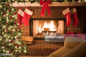 Christmas Livingroom by Christmas Tree And Decor Around The Fireplace With Blazing Fire