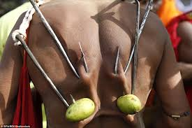 back hooks men in bangladesh hang themselves from hooks in charak puja