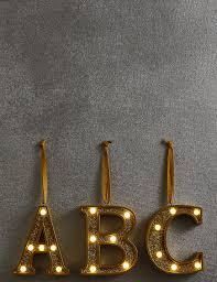 a z light up led gold alphabet baubles m s