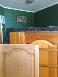 how to clean oak wood cabinets tasmanian oak kitchen cabinets before and after sanding