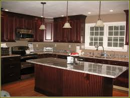 stone countertops kitchen with cherry cabinets lighting flooring