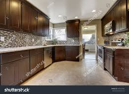 modern kitchen tile flooring modern kitchen interior dark brown storage stock photo 449123566
