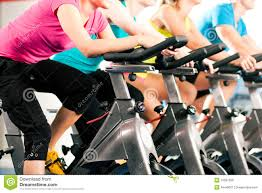 Indoor Bike Fitness Group Indoor Bicycle Cycling In Gym Royalty Free Stock