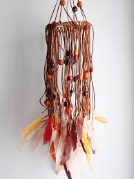 how to make a bohemian chandelier with feathers and beads hgtv